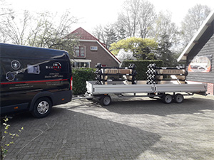 full trailer loaded with axles for Fifth Wheel Company.